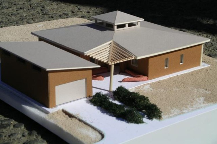 A model of a straw-bale insulation and earthen clay wall home built by the Pinoleville Pomo Nation in Ukiah, California.