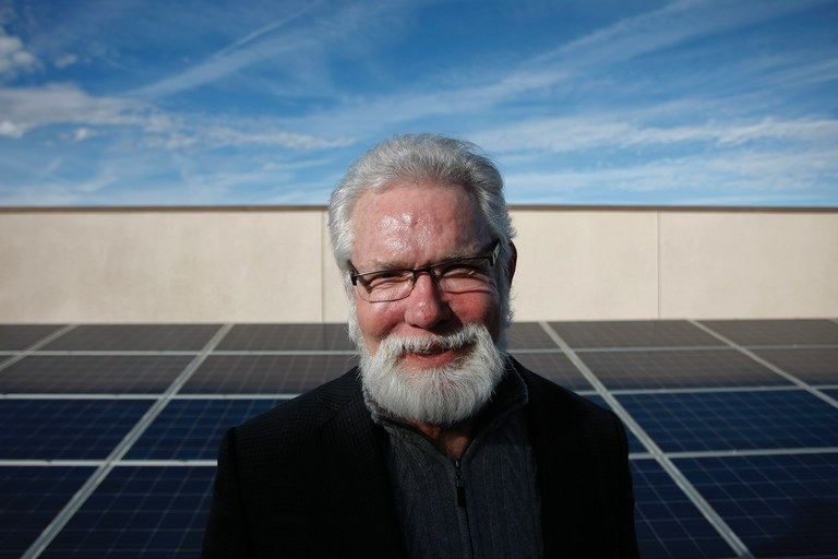 Lancaster, California, Mayor R. Rex Parris poses with the solar panels that sit atop City Hall. Parris wants to ban dirty energy, and is battling neighboring Palmdale over its proposed hybrid gas/solar plant.