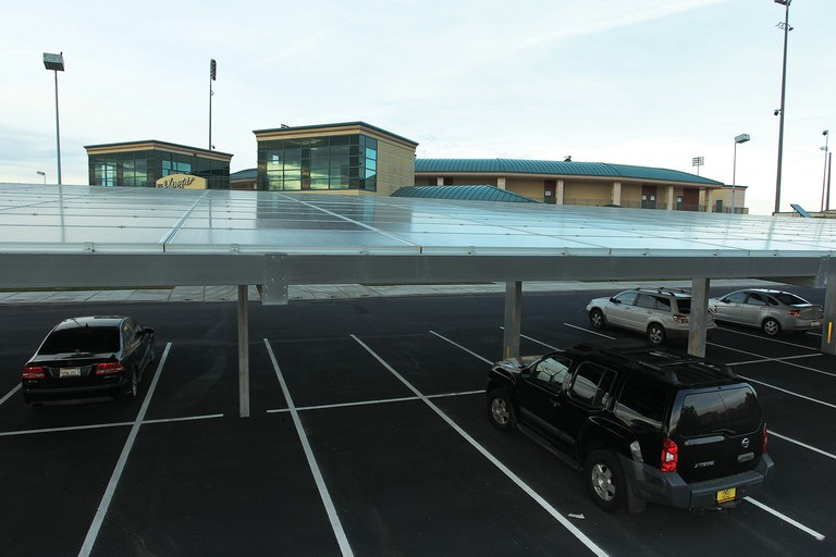 A SolarCity solar panel-covered parking structure at the JetHawk stadium, above, which generated 70 percent of the energy it used last year.