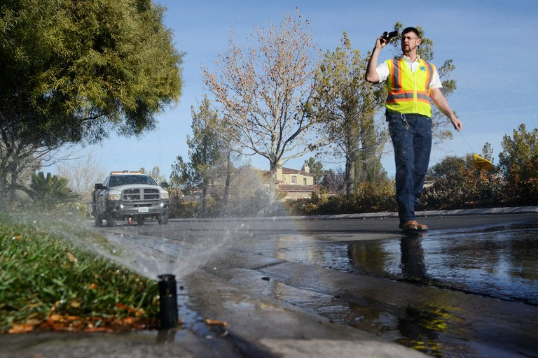 Long derided as the over-the-top desert city that shouldn't exist, Las Vegas is trying to become more water-efficient. Las Vegas Valley Water Authority water waste investigator Neil Bailey videotapes as water from a south Las Vegas lawn irrigation system flows onto the street, a violation.