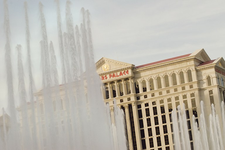 Caesar's Palace behind the Bellagio's famous fountain, which uses recycled water.
