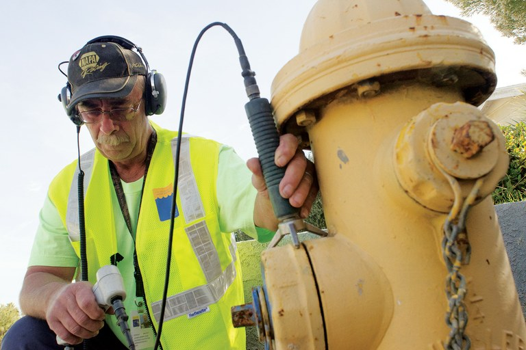 Las Vegas Valley Water Authority technician Don Bryant listens for signs of leaking water mains.