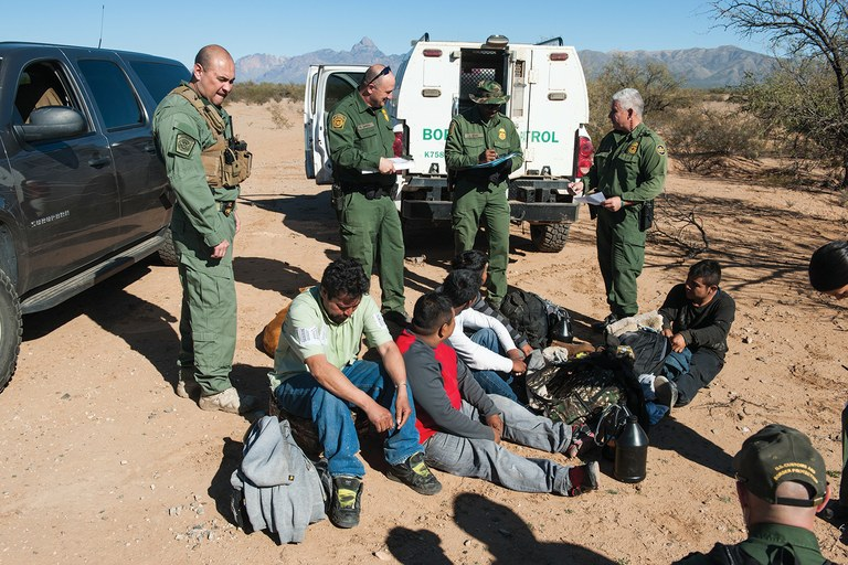 Border Patrol agents detain suspected undocumented immigrants in January near Sells, Arizona, on the Tohono O'odham Indian Nation.