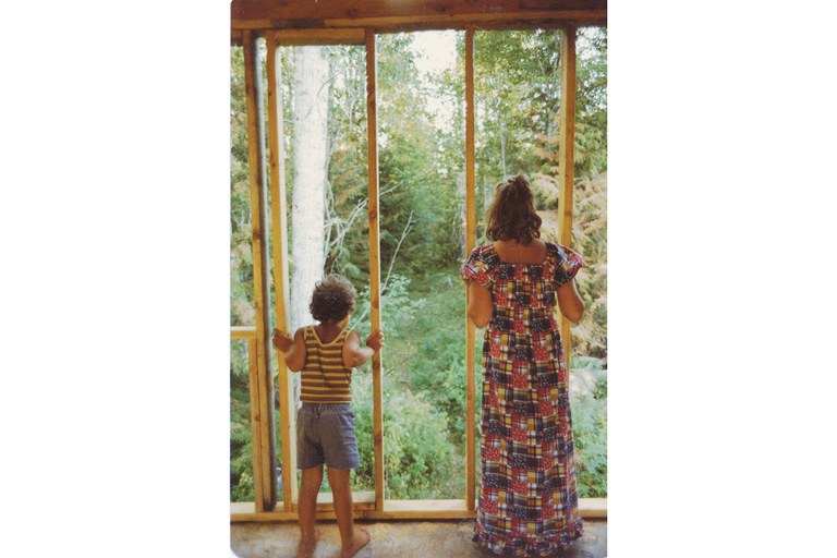 Julian and his sister during construction of their mother Barbara's cabin outside Sandpoint, Idaho.