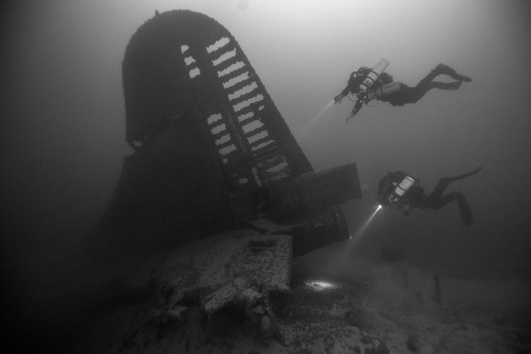 National Park Service Submerged Resources Center divers explore a B-29 Superfortress bomber resting in Lake Mead since 1948.