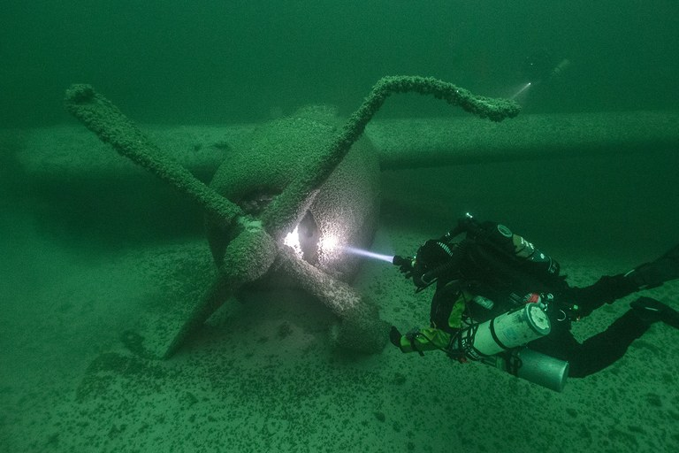 SRC Archeologist and Chief Dave Conlin examines the #1 engine of the B29 in Lake Mead National Recreation Area.