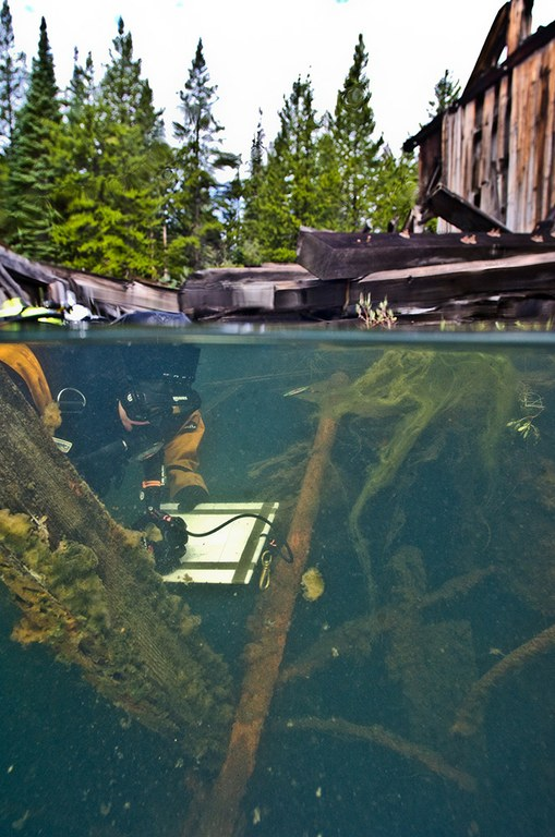 SRC Archeologist and Chief Dave Conlin measures the submerged remains of the Reiling Gold Dredge in Breckenridge, Colorado.