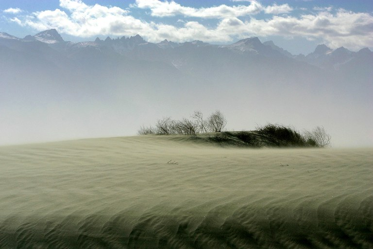 High winds blow sand over the original north shore of Owens Lake.