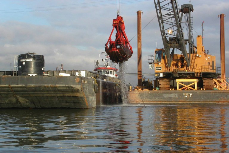 "Dredging near T-117 on the Duwamish River. ""Cleaning the site is probably impossible,"" says a Port of Seattle official."