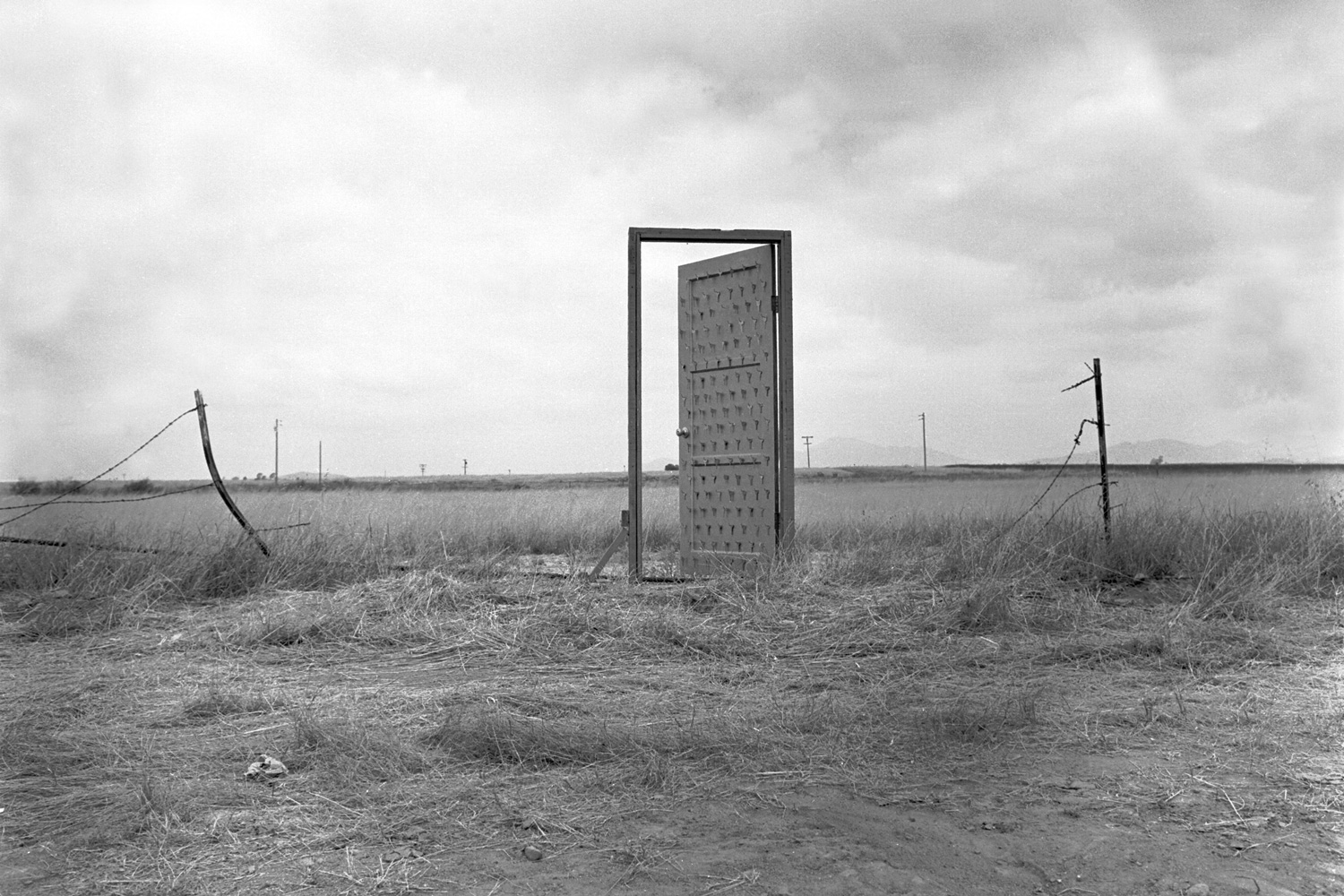 on the edge edward abbey charles ives and the outlaws on border door by richard lou an art installation created in 1988 on the u s border near tijuana after installing the workable standing gold