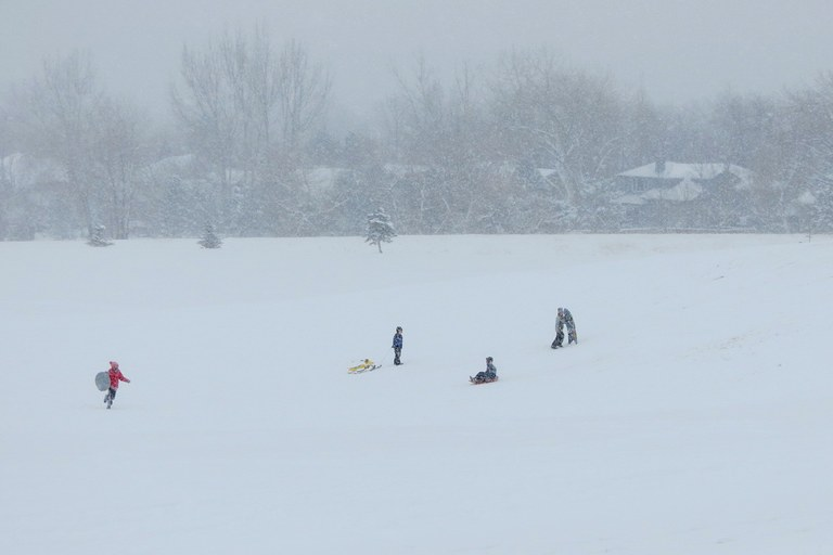 Children play in the snow in Colorado.