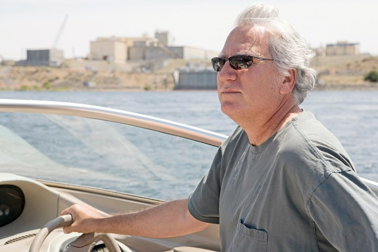 "Lawyer Tom Carpenter, shown on the Columbia River with Hanford buildings in the background, has helped hundreds of whistleblowers navigate the legal process in disputes over what he calls ""heinous behavior"" of bosses."