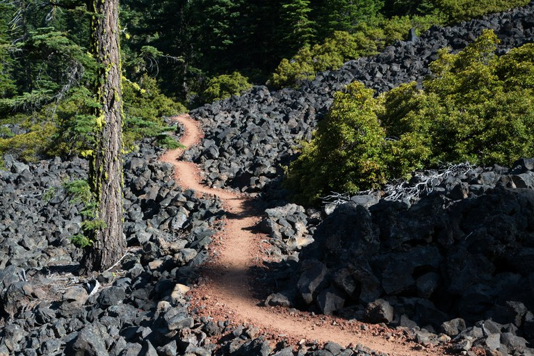 PCT Mile 1776: Trail through volcanic rocks, Rogue River-Siskiyou National Forest, Oregon.