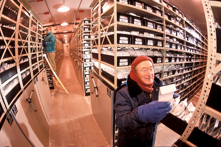 At the National Center for Genetic Resources Preservation in Fort Collins, Colorado, plant physiologist Loren Wiesner (right) and technician Bill Prange retrieve seed samples from a –18°C (0°F) storage vault for distribution to sites for cultivar development or study.
