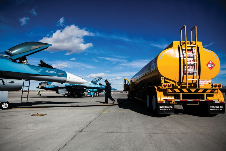 Jack Allen refuels an F-16 fighter jet, left, at Fallon Naval Air Station. Jet fuel, which has carcinogenic components, is pumped through Fallon in a Kinder Morgan pipeline that many people believe has leaked.