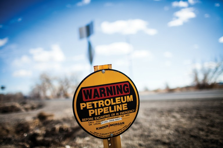Signs mark the Kinder Morgan jet fuel pipeline that travels through Fallon.
