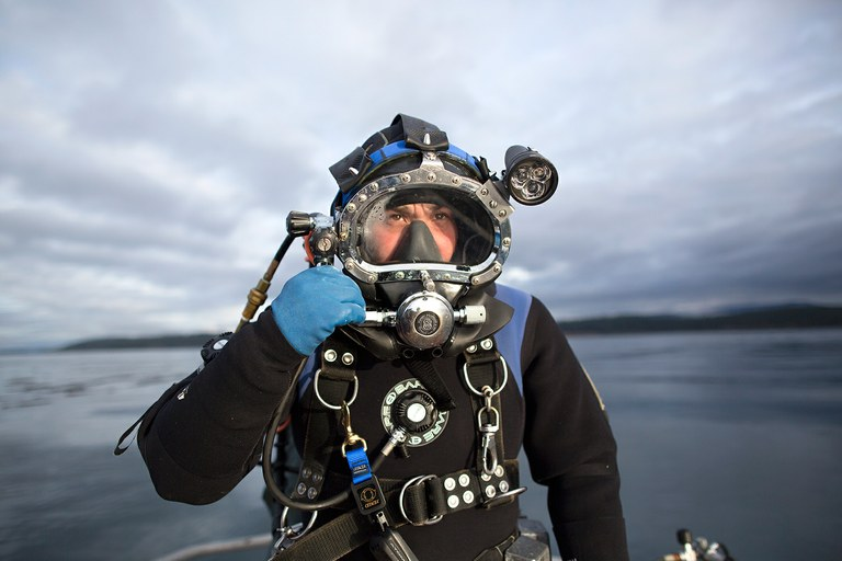 Williams wears a full-body dry suit and a pair of baseball catcher's shin guards to protect himself and the suit when diving for red sea urchins off the coast of Washington.