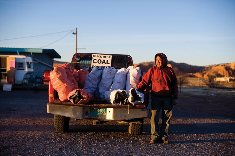 Ronald Begay sells coal on the side of Highway 118 in Gallup, New Mexico. Begay makes the trip to Black Mesa, Arizona, to purchase coal several times a week, which he then sells at several locations on or near the reservation.