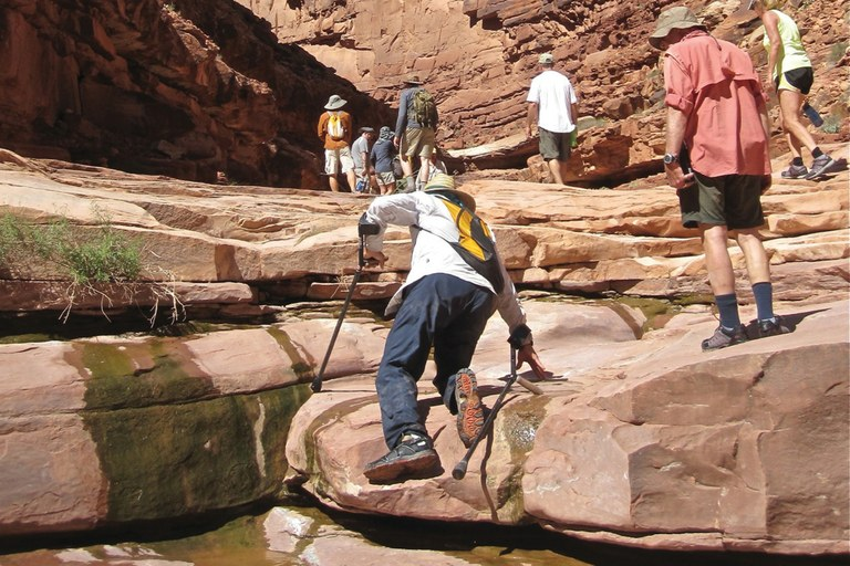 Jon Arnow crutch-walks – or crawls, when necessary – up a trail in North Canyon during a recent Grand Canyon rafting trip.