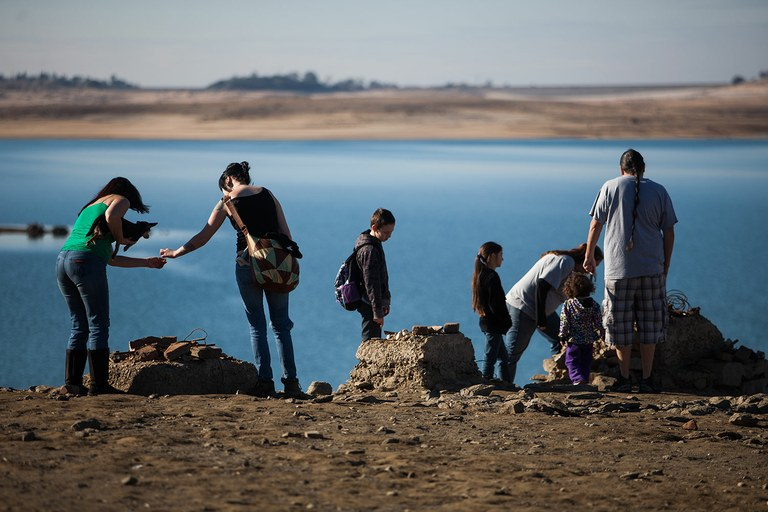 A mile from Mormon Island, visitors examine artifacts from the long-submerged town of Red Bank as Folsom Lake recedes under drought conditions in California.