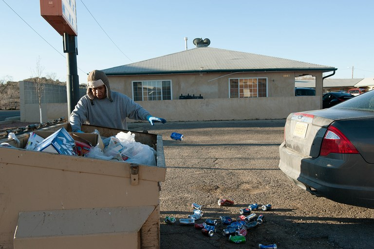 An aluminum can collector makes rounds on a Sunday morning. The city continues to struggle with economic and social problems.