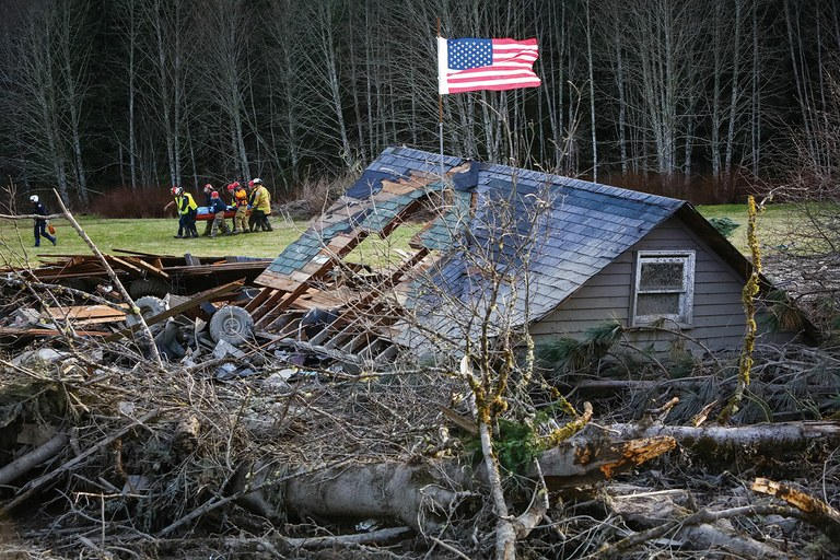A recovery team carries out a victim of the Oso, Washington, mudslide.