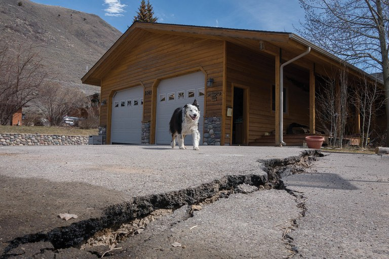 Pepi surveys the buckled driveway of a home on Budge Drive in Jackson, Wyoming, an area that was evacuated in early April.