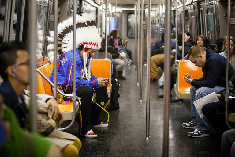 Deal rides the subway in costume.