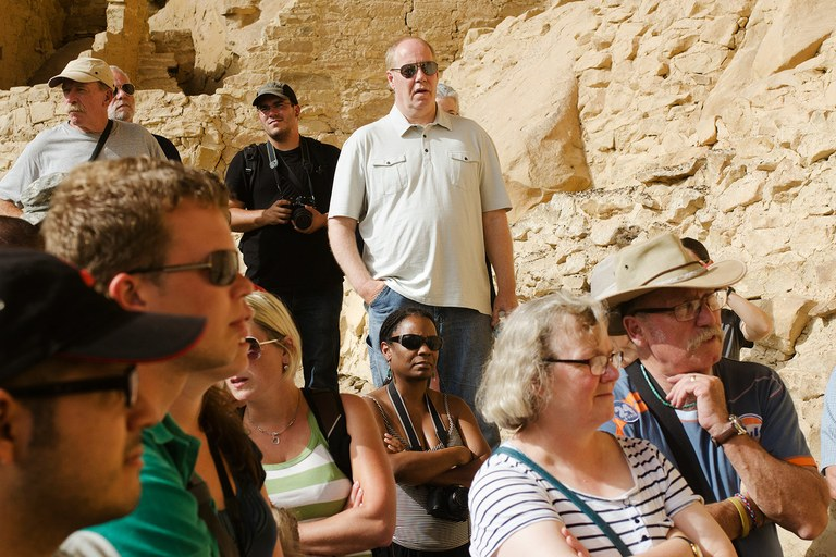 African-American tourists like Daneisha Hazard, center bottom, are scarce at remote national parks such as Mesa Verde, despite decades of effort by the Park Service to encourage diversity among its staff and visitors.