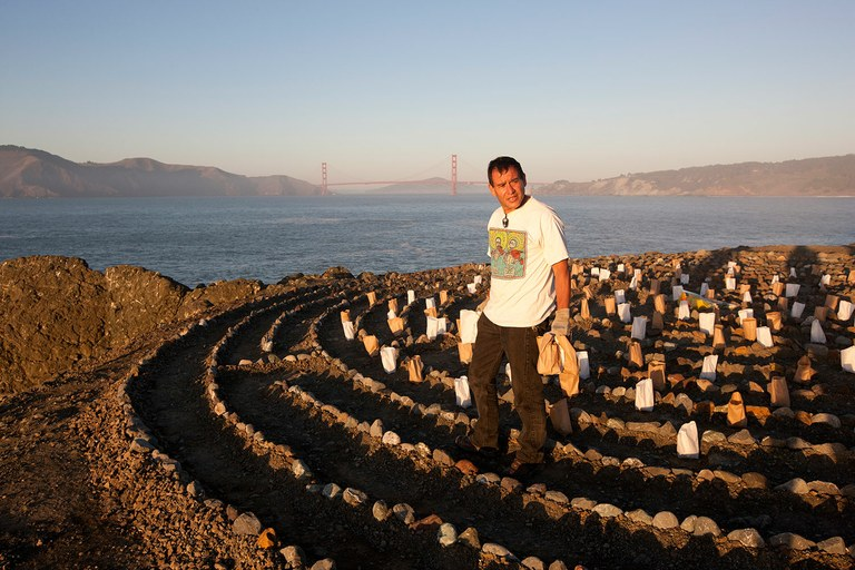 Eduardo Aguilara places luminarias at the Lands End Labyrinth in Golden Gate National Recreation Area outside of San Francisco, one of the nation's first urban parks.
