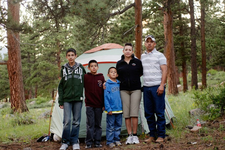 The Mendoza family – from left, Eduardo, Steven, Adrian, Diana and Ricardo – in front of their tent while camping in Colorado's Rocky Mountain National Park with Camp Moreno, an organization that encourages urban minority families to visit public lands.