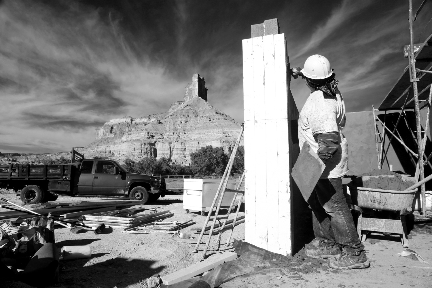 a giant resort overshadows a tiny colorado town passing through a construction worker from grand junction works on infrastructure for employee housing at gateway canyons resort that will include a pool a gym and more