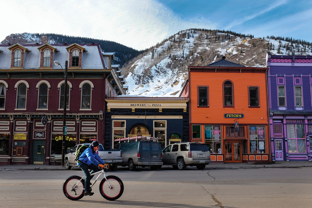baf9b54ac61 A bicyclist rides through the sleepy streets of Silverton this winter where  the old storefronts have been spruced up to serve the tourist economy.