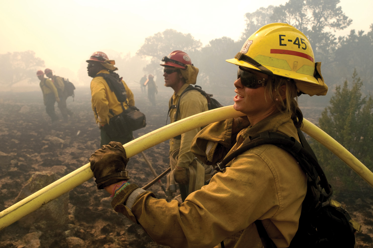Firefighter Michelle Bletcher works the initial attack with her crew ...