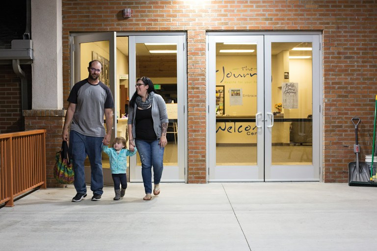 Elizabeth Tucker leaves a church-sponsored addict support group with her husband, Adam, whom she met in parole court and did meth with, and her daughter Emma. Elizabeth Tucker was one of Joel Miller's former patients who eventually became addicted to meth. Now that she's in recovery she organizes the local Narcotics Anonymous group, one of the few services available for recovering addicts in Craig. (Brooke Warren/High Country News)