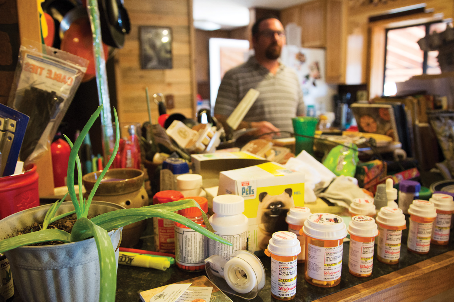Some of Flaharty's many prescriptions line the counter top at the home of his parents in Craig, Colorado, where he's been staying since he got out of jail. (Brooke Warren/High Country News)