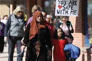 What should a community do to protect its immigrants?