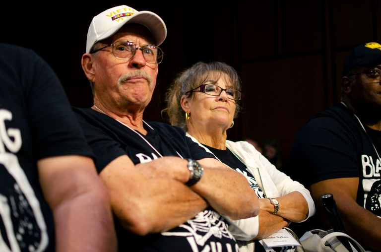 Alongside his wife Linda, Glenn Sykes, who spent 32 years as a coal miner in Appalachia, listens to senators and union representatives at a black lung roundtable in Washington, D.C. Mark Olalde/Center for Public Integrity