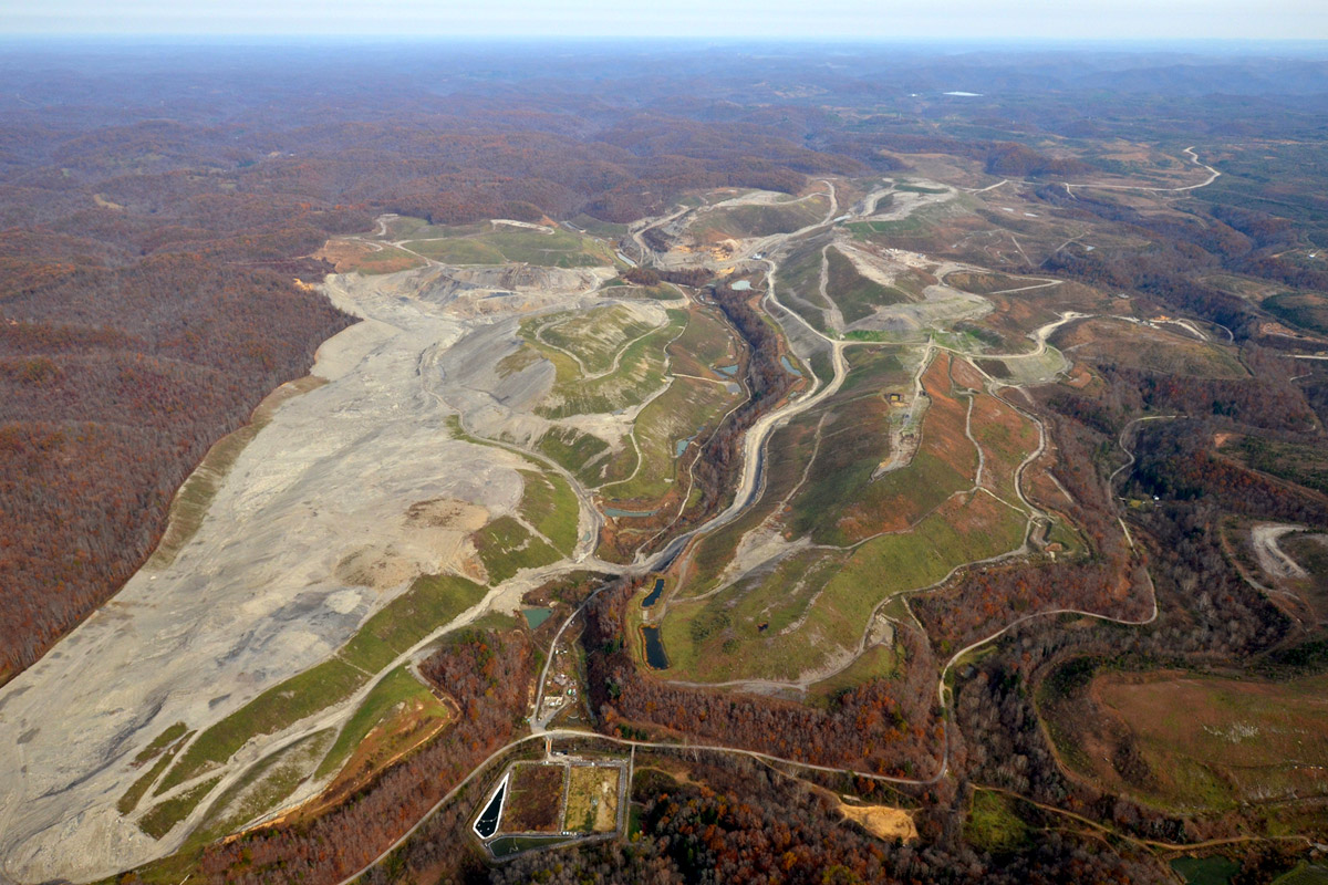 The Hobet 21 mountaintop removal coal mine, which leveled peaks in West Virginia, undergoes reclamation in 2017. (Photo by Mark Olalde/Center for Public Integrity)