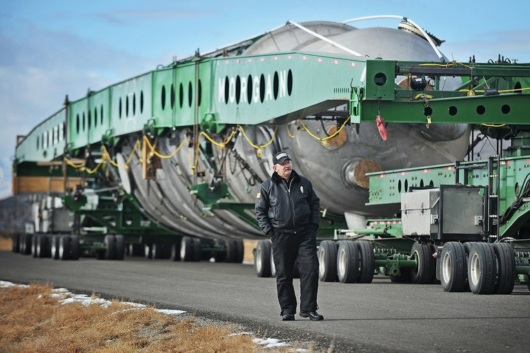 Dec. 31, 2013, a security officer walks past a megaload at a stopping point outside of Arco, about 50 miles west of Idaho Falls, Idaho. The megaloads are bound for Canada's disputed tar sands energy development, and they have been a focal point for protesters.